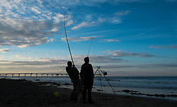 © Licensed to London News Pictures. <br /> 12/10/2014. <br /> <br /> Saltburn, United Kingdom<br /> <br /> Fishermen take part in the annual Jim Maidens memorial beach fishing competition in Saltburn by the Sea in Cleveland. <br /> The competition is held each year to mark the death of Saltburn plumber and keen fisherman Jim Maidens who died in 1998 when he was killed after being swept overboard from his boat 'Corina' close to the beach at Saltburn.<br /> <br /> Photo credit : Ian Forsyth/LNP