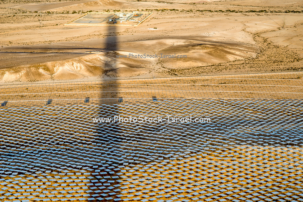 The reflecting mirrors at the Ashalim Solar Power station. A solar thermal power station in the Negev desert near kibbutz Ashalim, in Israel. The station will provide 121 Megawatt of electricity (2.0% of the Israeli consumption), which makes it the largest of its kind in Israel and 5th largest in the world. The mirrors focus sun rays onto the tower, thus producing steam