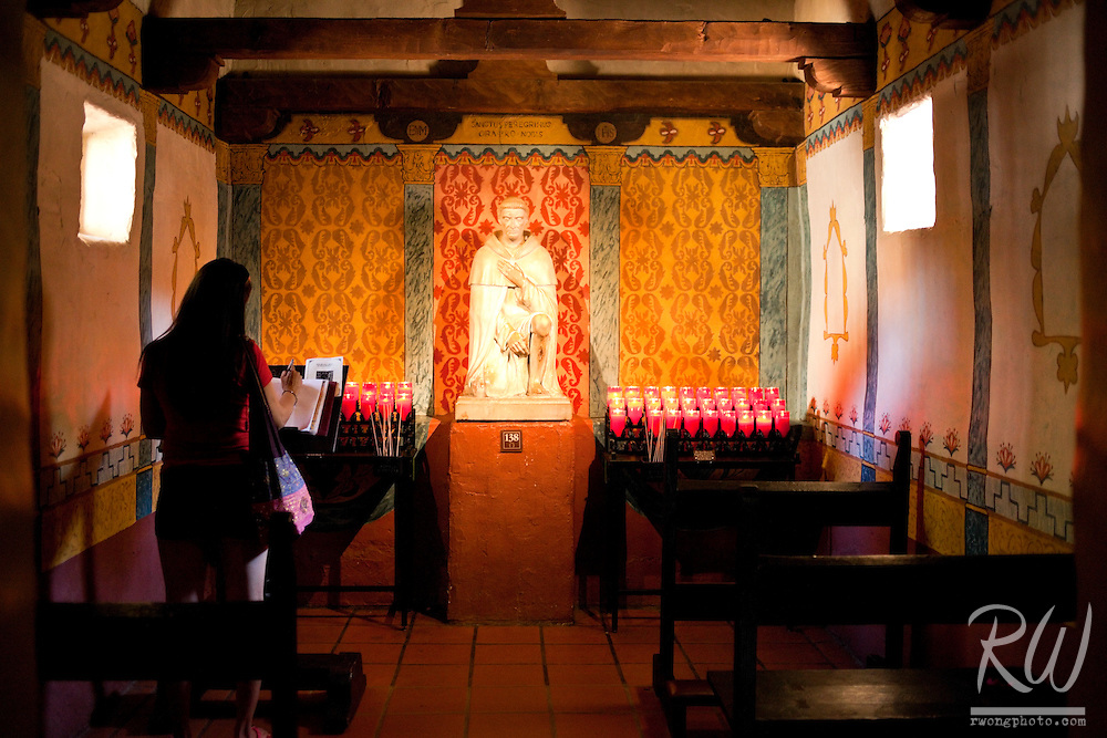 Woman in St. Peregrine's Chapel, Mission San Juan Capistrano, California