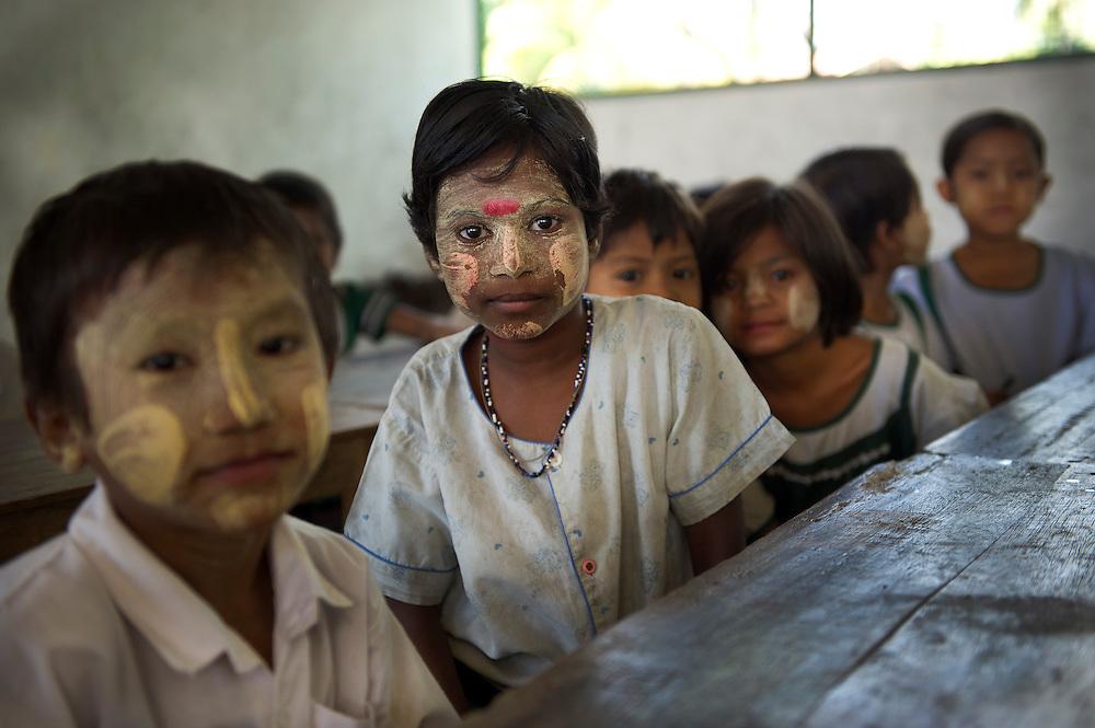 Children made orphans by Cyclone Nargis live and study at a Monastery in Dalah, Yangon (Rangoon) Myanmar (Burma) January 2012
