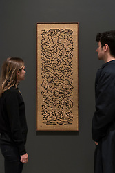 "© Licensed to London News Pictures. 09/10/2018. LONDON, UK. Visitors view ""Epitaph"", 1968, by Anni Albers.  Preview of the UK's first exhibition of works by German artist Anni Albers at Tate Modern who used the ancient art of hand-weaving to produce works of modern art.  Over 350 of her artworks from major collections from Europe and the US are on show 11 October to 27 January 2019.  Photo credit: Stephen Chung/LNP"