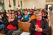 19 DECEMBER 2010 - PHOENIX, AZ: ELIAS BERMUDEZ, (right front) a supporter of immigrants' rights, participates in a prayer service for the DREAM Act in Phoenix. About 100 supporters of the DREAM Act gathered at First Congregational Church of Christ in Phoenix Sunday night, December 19, for a prayer vigil in support of the DREAM Act, which was defeated in the US Senate Saturday, Dec. 18. The DREAM Act, was supported by the Obama administration, and was an important part of the administration's immigration reform platform. The defeat of the DREAM Act, which would have established a path to citizenship for undocumented immigrants who were brought to the US by their parents when they were children, set back the President's immigration reform efforts.    PHOTO BY JACK KURTZ