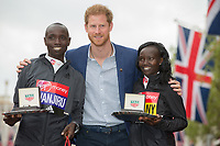 Daniel Wanjiru KEN and Mary Keitany KENpose with HRH Prince Henry of Wales (Prince Harry). The Virgin Money London Marathon, 23rd April 2017.<br /> <br /> Photo: Jed Leicester for Virgin Money London Marathon<br /> <br /> For further information: media@londonmarathonevents.co.uk