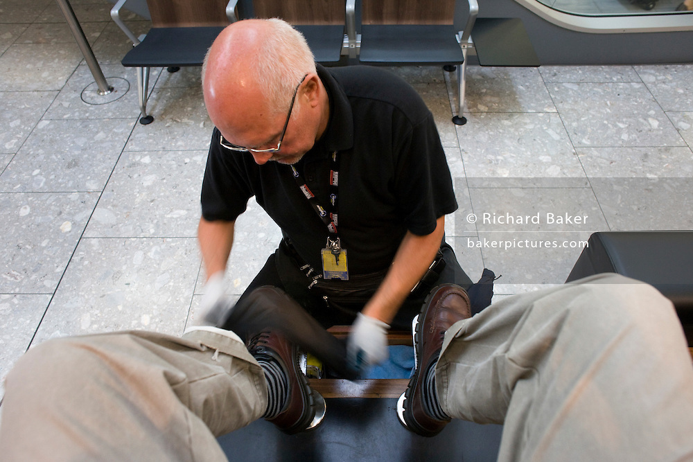 Long-term shoe-shine franchise owner Dudley Masters polishes a pair of shoes at Heathrow's Terminal 5.