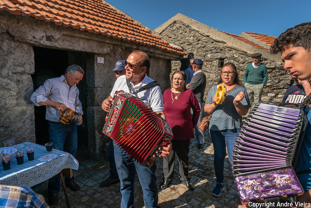 Residents of Vilarinho Seco, one of the oldest villages in the Barroso region, sing and drink after a religious procession. Catholic celebrations dictate the rythim of life in the Barroso, with festivals and processions marking every agriculture cycle
