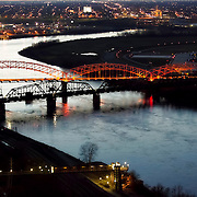Broadway Bridge over the Missouri River at Kansas City, MO at dusk, aerial photo. The Broadway Bridge is a triple-arch bridge, which opened in 1956.