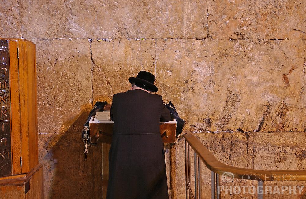 JERUSALEM, ISRAEL - FEB-28-2005 - The faithful pray at the Western Wall in the Jerusalem's Old City. (PHOTO © JOCK FISTICK)