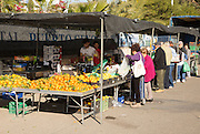 People buying fruit and vegetables at market stall, San Jose, Almeria, Spain