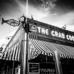 "The Crab Cooker restaurant in Newport Beach black and white photo.  The Crab Cooker is a very popular local seafood restaurant known for its bright red exterior and fish sign that says ""Don't Look Up Here"". The Crab Cooker is located at 2200 Newport Blvd., Newport Beach CA 92663"