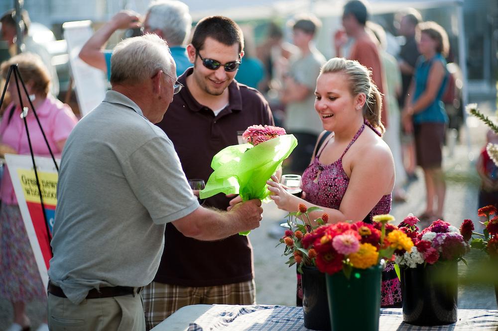 Flower farmer selling flowers at  farmers market