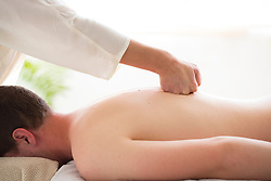 Man Receiving Back Massage, Close-up view