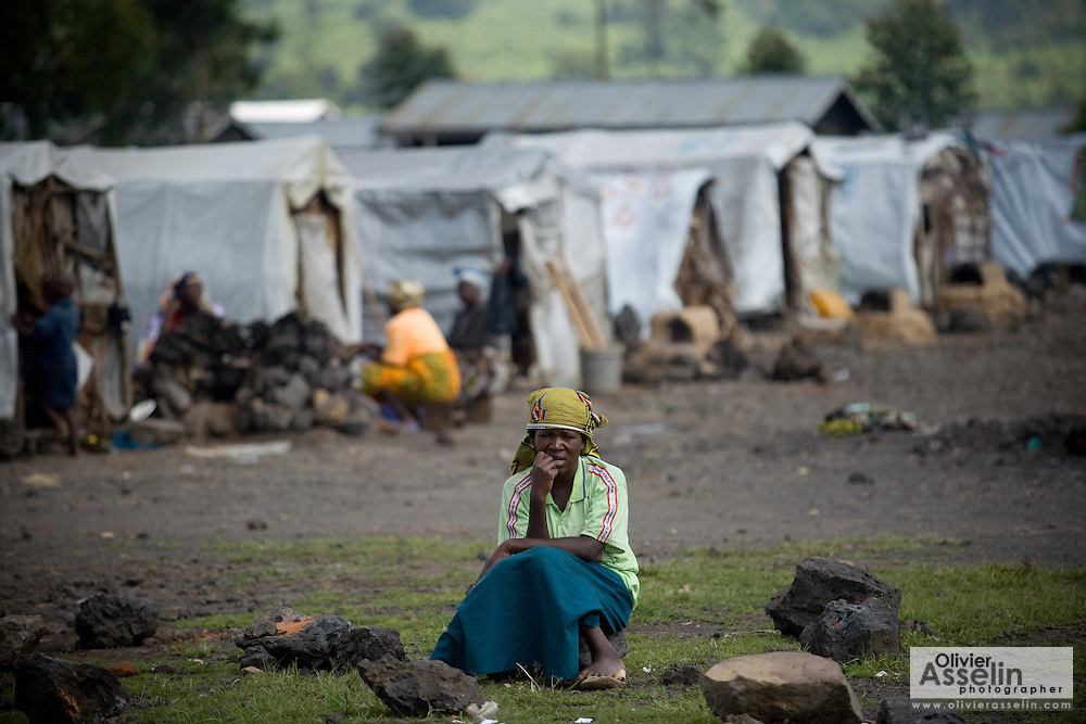 An internally displaced woman sits on a stone at the Kibati IDP camp on the outskirts of Goma, Eastern Democratic Republic of Congo on Friday December 12, 2008.