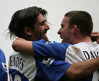 Photo: Lee Earle.<br /> Portsmouth v Manchester City. The Barclays Premiership. 11/03/2006. Pompey's Sean Davis (R) congratulates Pedro Mendes after his opening goal.