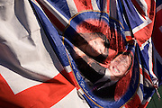 The faces of Prince William and his wife-to-be Kate Middleton, appearing on flags on a tourist kiosk in central London.