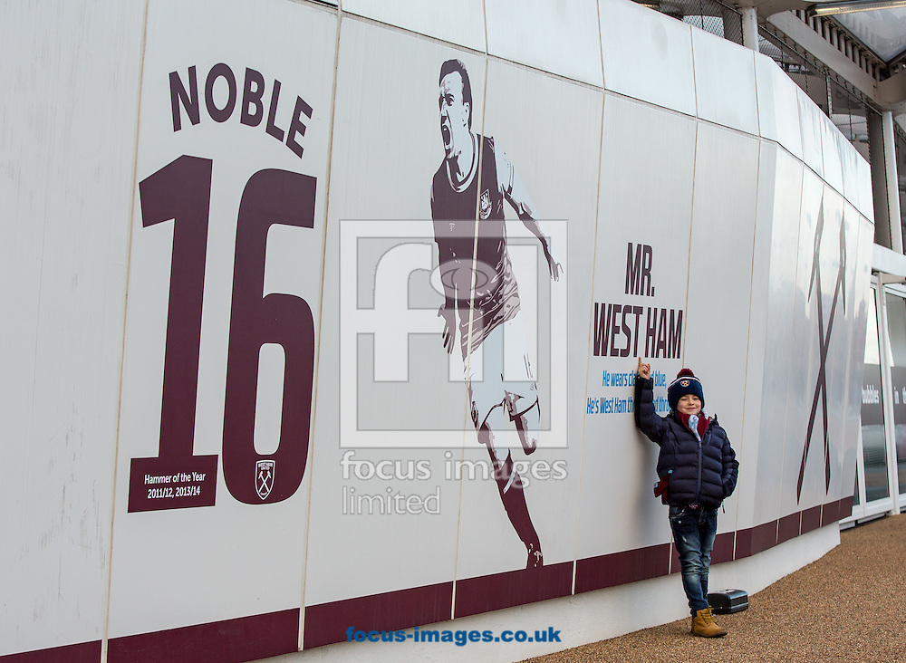 A young West Ham fan poses with the Mr West Ham signage of Mark Noble outside the London Stadium during the Premier League match at the London Stadium, Stratford<br /> Picture by Liam McAvoy/Focus Images Ltd 07413 543156<br /> 14/01/2017