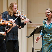 November 15, 2011 - Manhattan, NY : The Theatre of Early Music including, from left, violinist Cynthia Roberts, violinist Edwin Huizinga, and soprano Deborah York, perform works by George Frideric Handel in the Joan and Sanford I. Weill Recital Hall at Carnegie Hall on Tuesday night. CREDIT: Karsten Moran for The New York Times
