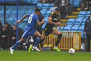 Jake Jervis of AFC Wimbledon (10) takes on Jonny Edwards of FC Halifax Town (10) during the The FA Cup 2nd round match between FC Halifax Town and AFC Wimbledon at the MBi Shay Stadium, Halifax, United Kingdom on 1 December 2018.