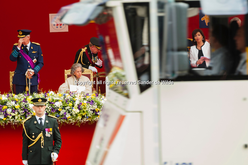 Belgiums National Day  in Brussels July 21, 2012. Belgium celebrates its national day and its 182nd anniversary of independence on this Saturday with a military parade in front of the Royal Palace.From left to right  Prince Philip,Princess Fabiola and vice prime minister Milquet visible through the window of a police vehicle passing