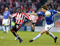 Photo: Leigh Quinnell.<br /> Leicester City v Southampton. The FA Cup. 28/01/2006.<br /> Southamptons Nathan Dyer and Leicesters Nils-Eric Johansson both look for the ball.
