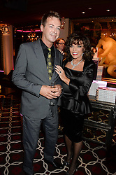JULIAN CLARY and JOAN COLLINS at a party to celebrate the publication of 'Passion for Life' by Joan Collins held at No41 The Westbury Hotel, Mayfair, London on21st October 2013.