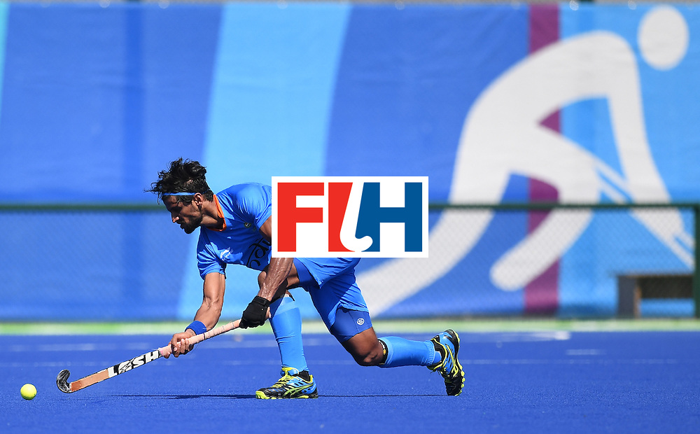 India's Rupinder Pal Singh hits the ball during the men's field hockey India vs Ireland match of the Rio 2016 Olympics Games at the Olympic Hockey Centre in Rio de Janeiro on August, 6 2016. / AFP / MANAN VATSYAYANA        (Photo credit should read MANAN VATSYAYANA/AFP/Getty Images)