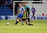 Burton No 34 Hamza Choudhury gets in a tackle in the Sky Bet League 1 match between Colchester United and Burton Albion at the Weston Homes Community Stadium, Colchester, England on 23 April 2016. Photo by Nigel Cole.