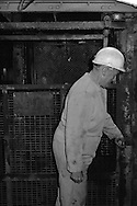 Banksman closing the pit cage at Markham Main Armthorpe Colliery. National Coal Board, Doncaster Area 21/06/1983.