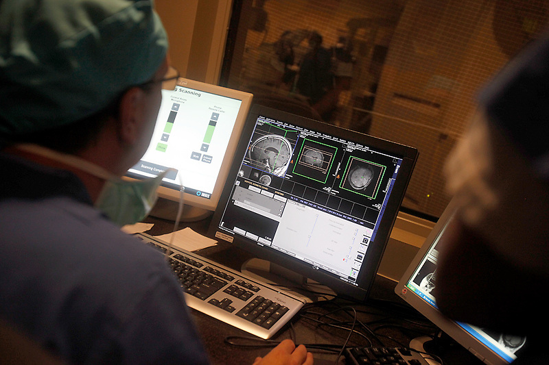 While the iMRI machine is scanning, doctors study the images in a separate room.