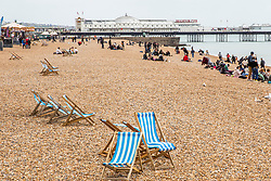 © Licensed to London News Pictures. 05/05/2019. Brighton, UK. Only a handful of visitors can be seen on the beach in Brighton and Hove as cold and grey weather is hitting the seaside resort over the May Bank Holiday weekend. Photo credit: Hugo Michiels/LNP