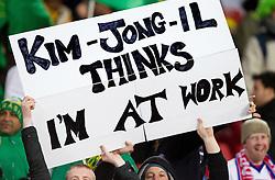 15.06.2010, Ellis Park, Johannesburg, RSA, FIFA WM 2010, Brasilien vs Nordkorea im Bild Fanfeature Fans halten eine Tafel hoch mit der Aufschrift Kim-Jong-Il Thinks I´m At Work, dies soll eine Anspielung auf das Ausreiseverbot der Nordkoreanischen Regierung für Fans die zur Fussball WM nach Südafricka wollten, sein, EXPA Pictures © 2010, PhotoCredit: EXPA/ Sportida/ Vid Ponikvar