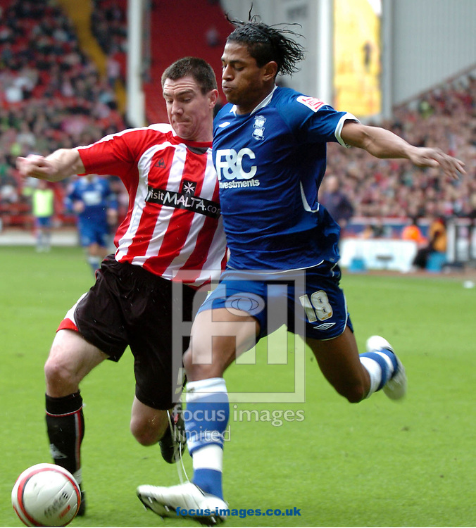 Sheffield - Sunday, March 1st, 2009:  Birmingham City's Carlos Costly battles for the ball wit Sheffield Utd's Chris Morganduring the Coca Cola Championship match at Bramall Lane, Sheffield. (Pic by John Rushworth/Focus Images)