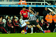 Jamaal Lascelles (#6) of Newcastle United challenges Marcus Rashford (#10) of Manchester United during the Premier League match between Newcastle United and Manchester United at St. James's Park, Newcastle, England on 2 January 2019.