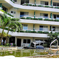 Car in Hotel and Truck Sunk in Pool After Tsunami on Patong Beach in Phuket, Thailand <br />