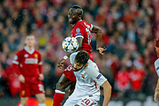 Liverpool striker Sadio Mane (19) challenges in the air  during the Champions League semi final leg 1 of 2 match between Liverpool and Roma at Anfield, Liverpool, England on 24 April 2018. Picture by Simon Davies.