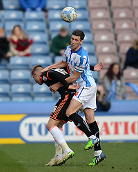 Huddersfield Town's Mark Hudson competes with Fulham's Cauley Woodrow - Photo mandatory by-line: Richard Martin-Roberts/JMP - Mobile: 07966 386802 - 21/03/2015 - SPORT - Football - Huddersfield - John Smith's Stadium - Huddersfield Town v Fulham - Sky Bet Championship