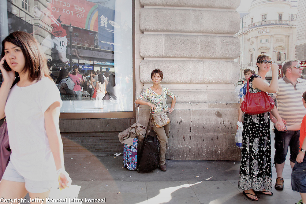 Piccadilly Pose Residents and tourist striking a pose at Piccadilly Circus in London, England.