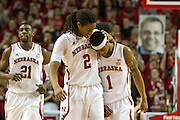 January 20, 2014: David Rivers (2) of the Nebraska Cornhuskers gives Deverell Biggs (1) of the Nebraska Cornhuskers a hug after a good play against the Ohio State Buckeyes at the Pinnacle Bank Arena, Lincoln, NE. Nebraska won in the game against Ohio State 68 to 62.