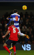 Picture by David Horn/Focus Images Ltd +44 7545 970036<br /> 07/12/2013<br /> Charlie Austin of Queens Park Rangers heads goalward during the Sky Bet Championship match at the Loftus Road Stadium, London.