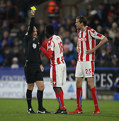 Referee Anthony Taylor shows Mame Biram Diouf of Stoke City a yellow card - Mandatory by-line: Jack Phillips/JMP - 26/12/2017 - FOOTBALL - The John Smith's Stadium - Huddersfield, England - Huddersfield Town v Stoke City - English Premier League