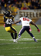 Houston Texans wide receiver Andre Johnson (80) tries to tackle Pittsburgh Steelers strong safety Troy Polamalu (43) as he runs with the ball after recovering a fumble by Houston Texans wide receiver DeAndre Hopkins (10) on a pass reception for a 32 yard gain and a strip by Pittsburgh Steelers free safety Mike Mitchell (23) in the fourth quarter during the NFL week 7 regular season football game against the Pittsburgh Steelers on Monday, Oct. 20, 2014 in Pittsburgh. The Steelers won the game 30-23. ©Paul Anthony Spinelli