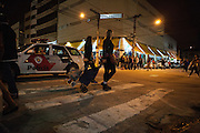 Police patrolling close to the illegal nightmarkets on the streets of São Paulo, Brazil.<br /> <br /> Nearly 90% of the immigrants arriving in São Paulo end up working in the textile industry. Today there are about 20,000 sewing shops in São Paulo and 400,000 immigrants working in the clothing sector.