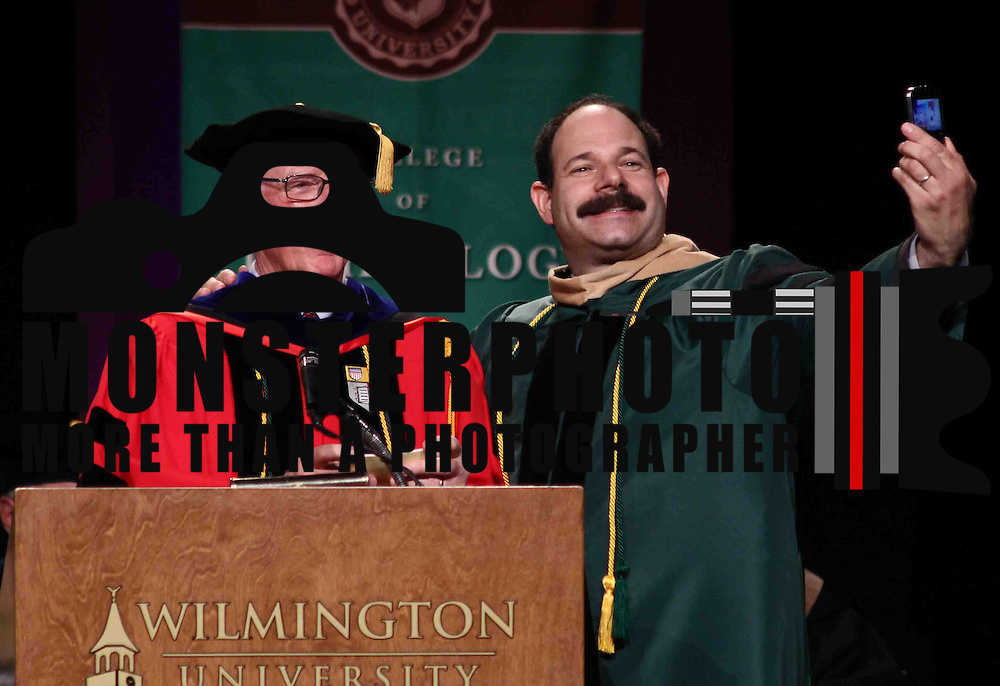 Doctoral degree candidate Andrew S. Labovitch, RIGHT, takes selfie with Dr. Donald W. Durandetta, Ph. D. during Wilmington University commencement exercise Sunday, May 17, 2015, at Chase Center On The Riverfront in Wilmington Delaware.