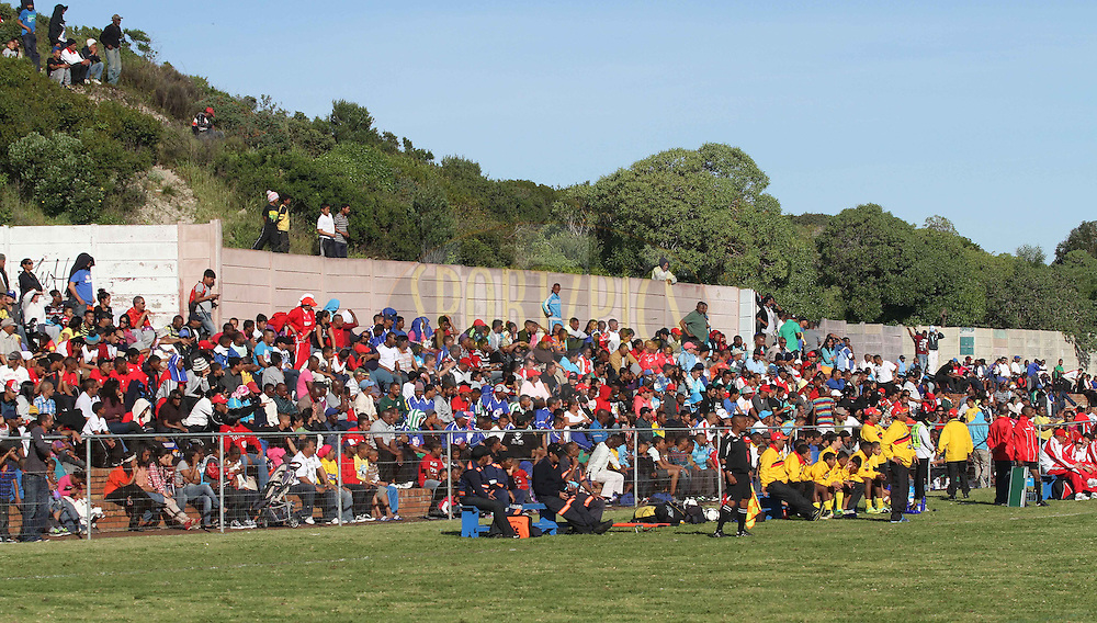 Spectators enjoy the action during the Final on the final day of the Engen Knock Out Challenge held at Stephen Reagan Sports Ground, Mitchells Plain in Cape Town on the 30th September 2012..Photo by Shaun Roy/ SPORTZPICS..