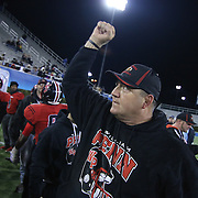 William Penn Head Coach Marvin Dooley celebrate after William Penn defeated Middletown 42-14 for the state title Saturday, Nov. 29 2014, at Delaware Stadium in Newark Delaware.