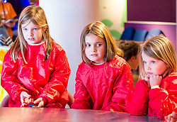 City Arts Centre, Edinburgh, Scotland, United Kingdom, 9 April 2019. Edinburgh Science Festival:  JIndia and Lucy, age 8 years, and Evie, age 6 years have fun learning about blood at the Blood Bar drop in event at the Science Festival. <br /> <br /> Sally Anderson | EdinburghElitemedia.co.uk