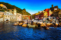 """""""Evening sailing port of Vernazza on the Angelina Dada""""…<br /> <br /> I began my daily journey at the northernmost town of Monterosso and took the train to the southernmost town of Riomaggiore. I sailed up the coast photographing each Cinque Terre town along the way aboard the Angelina Dada. The second to last village before my home destination was Vernazza, one of the busiest of the five, and the only one with a true bay. This image was taken sailing beyond the rocky breakwater during the late evening sun. Leaving for my destination of Monterosso, soft light illuminated the sky and azure sea of the Mediterranean convincing me to sail all the way back to Riomaggiore with my gracious guides Claudio and Eddie of """"Cinque Terre dal Mare"""" sailing excursions. We arrived just in time for a perfect sunset. After a nice dinner...I caught the last train at midnight back home to Monterosso."""