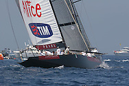 Italy's team Luna Rossa chases USA's BMW Oracle team after rounding mark during America's Cup fleet race; Valencia, Spain.