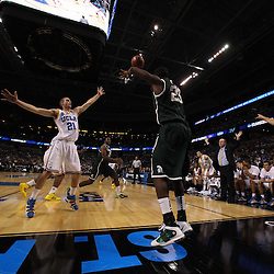 Mar 17, 2011; Tampa, FL, USA; Michigan State Spartans forward Draymond Green (23) inbounds a pass past UCLA Bruins forward Brendan Lane (21) during the first half of the second round of the 2011 NCAA men's basketball tournament at the St. Pete Times Forum.  Mandatory Credit: Derick E. Hingle
