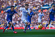 Mateusz Klich of Leeds United (43) sprints past Craig Noone of Bolton Wanderers (12) during the EFL Sky Bet Championship match between Leeds United and Bolton Wanderers at Elland Road, Leeds, England on 23 February 2019.