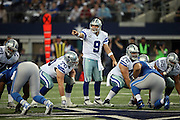 Dallas Cowboys quarterback Tony Romo (9) points as he calls a play over center during the NFL week 18 NFC Wild Card postseason football game against the Detroit Lions on Sunday, Jan. 4, 2015 in Arlington, Texas. The Cowboys won the game 24-20. ©Paul Anthony Spinelli